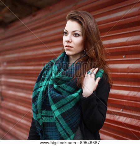 Portrait Of Pretty Woman With Big Beautiful Scarf.
