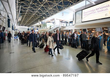 HELSINKI - SEP 03: passengers in Helsinki Airport on September 03, 2014 in Helsinki, Finland. Helsinki Airport  is the main international airport of the Helsinki metropolitan region