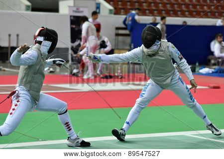 ST. PETERSBURG, RUSSIA - MAY 1, 2015: Francois-Olivier David of Canada vs Giorgio Avola of Italy in International fencing tournament St. Petersburg Foil. The tournament is the stage of FIE World Cup