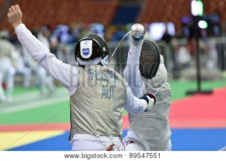 ST. PETERSBURG, RUSSIA - MAY 1, 2015: Markus Felner of Austria vs Takahiro Shikine of Japan in 41th International fencing tournament St. Petersburg Foil. The tournament is the stage of FIE World Cup