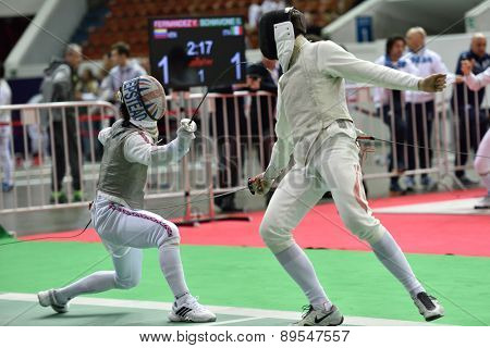 ST. PETERSBURG, RUSSIA - MAY 1, 2015: Marcus Mepstead of Great Britain vs Roland Schlosser of Austria in International fencing tournament St. Petersburg Foil. The tournament is the stage of World Cup