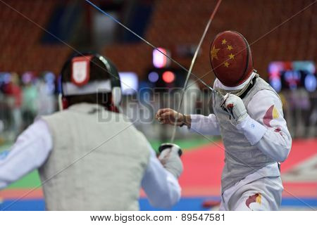 ST. PETERSBURG, RUSSIA - MAY 1, 2015: Szymon Kozlowski of Poland vs Haiwei Chen of China during 41th International fencing tournament St. Petersburg Foil. The tournament is the stage of FIE World Cup