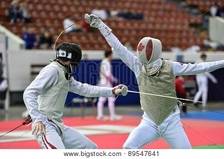 ST. PETERSBURG, RUSSIA - MAY 1, 2015: Martin Dobiasch of Austria vs Anthony Prymack of Canada in 41th International fencing tournament St. Petersburg Foil. The tournament is the stage of FIE World Cup