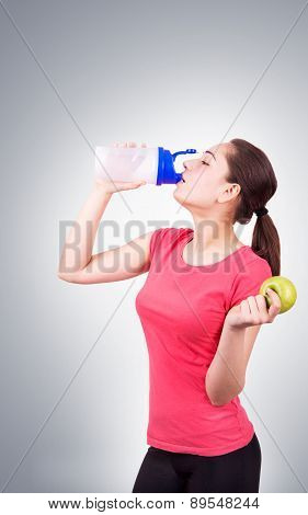 Young Girl Drinking A Shaker