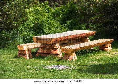 Wooden Table With Benches In A Pine Forest