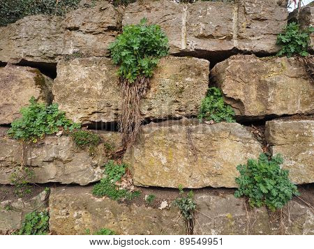 Medieval rough stone retaining wall