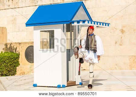 ATHENS, GREECE - APR 13, 2015: Evzone guarding the Tomb of the Unknown Soldier in Athens dressed in full dress uniform, refers to the members of the Presidential Guard, an elite ceremonial unit.