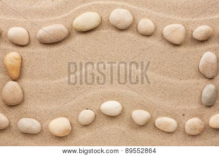 Frame Made Of White Stones On A Wavy Sand