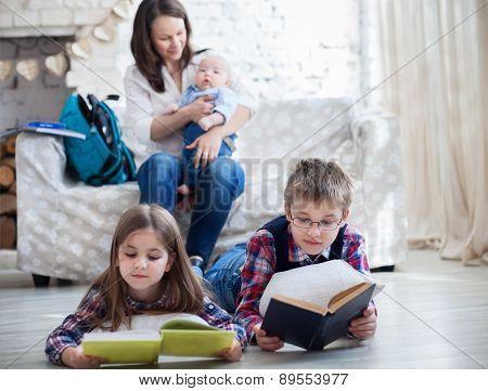 Children Readind Books In Living Room