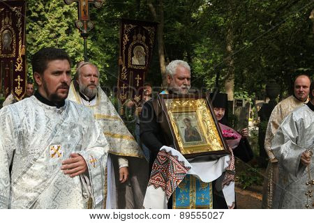 PRAGUE, CZECH REPUBLIC - MAY 28, 2012: Orthodox priest Josef Fejsak carries the miracle-working icon of the Virgin Mary to the Dormition Church at the Olsany Cemetery in Prague, Czech Republic.