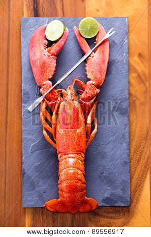 Lobster Clipping Limes On Cutting Board With Picks