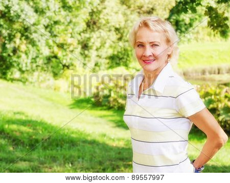 Portrait Of A Middle-aged Woman In A Park