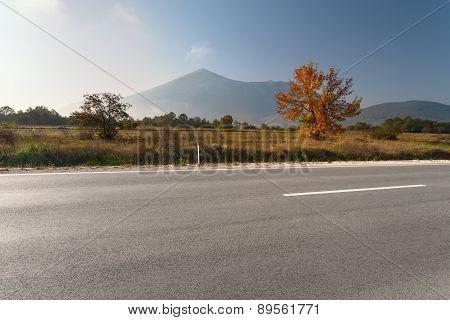Side View Of Empty Asphalt Road In Mountain Area