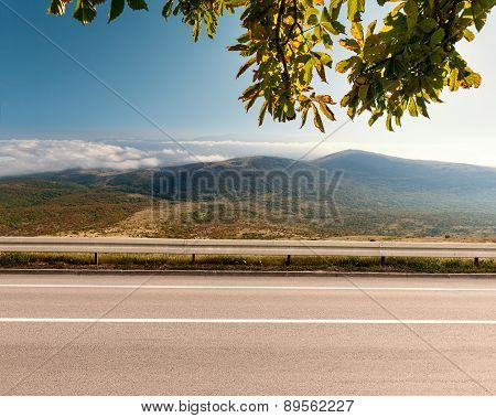 Side View Of Empty Highway In Mountain Area