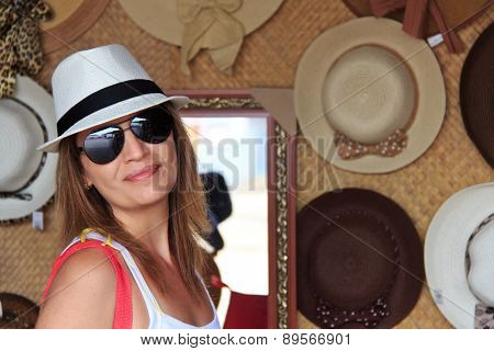 Brazilian woman shopping hat at touristic place in Brazil