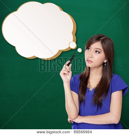 Beautiful student girl staring at a comical thinking bubble