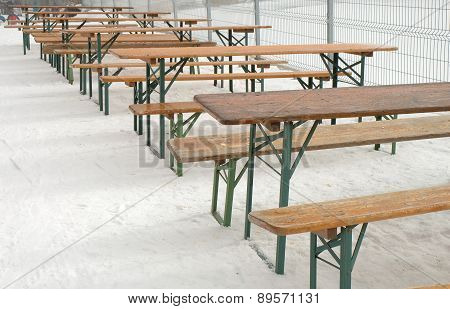 Row Of Empty Tables And Benches