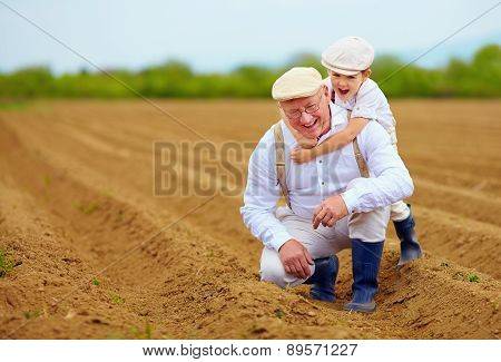 Happy Farmer Family Having Fun On Spring Field