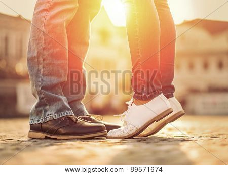 Couples foots stay at the street under sunlight