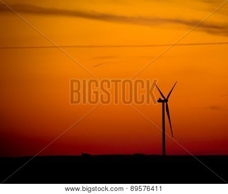 Silhouette Of  Wind Turbine At Sunset
