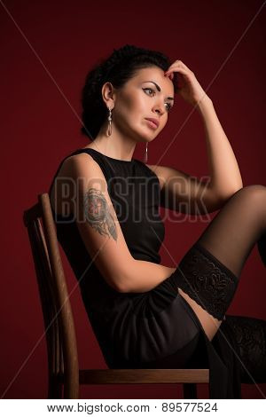 Studio portrait of a sexy brunette in black stockings