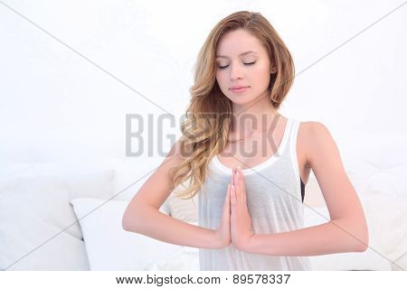 Woman doing yoga in bedroom