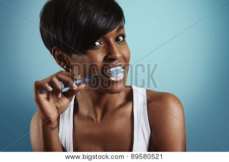 Woman Cleaning Her Teeth. Blue Background