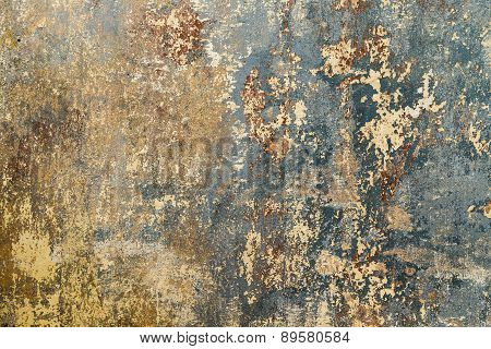 Old Grunge Wall Of An Old House With Remainings Of Color