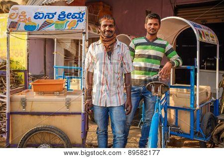 KAMALAPURAM, INDIA - 02 FEBRUARY 2015: Indian ice-cream vendors on a market close to Hampi.