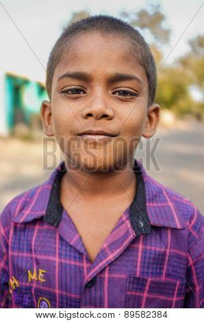 HAMPI, INDIA - 31 JANUARY 2015: Indian boy with proud expression