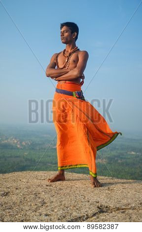 KAMALAPURAM, INDIA - 03 FEBRUARY: Indian pilgrim with religious necklaces and bindi in lungi on hilltop
