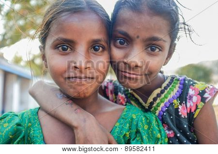 hAMPI, INDIA - 31 JANUARY 2015: Two Indian girls hugging and smiling