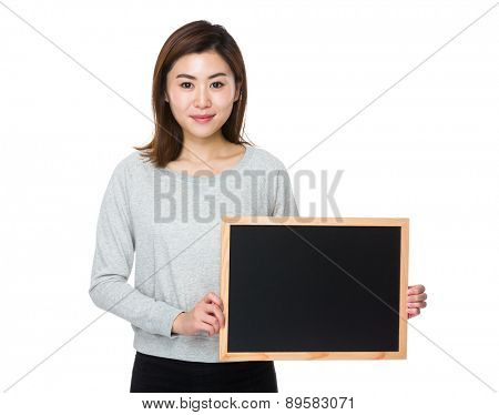 Young woman hold with chalkboard