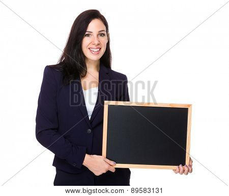 Brunette Businesswoman show with chalkboard
