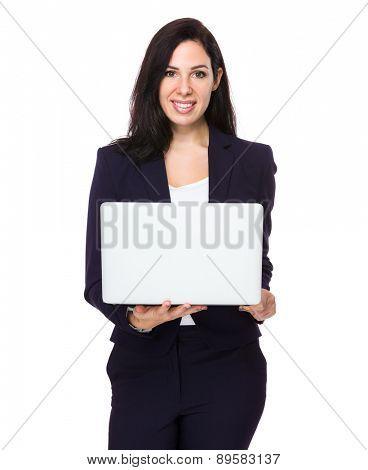 Brunette Businesswoman use of laptop