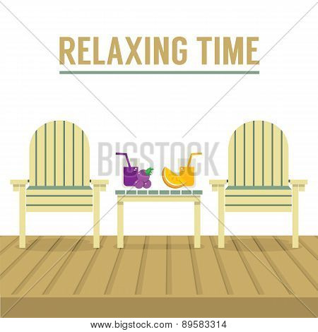 Wooden Chairs And Glasses Of Fruit Juice On Table.
