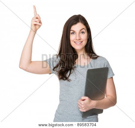 Caucasian woman hold with notebook computer and finger point up