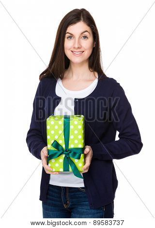 Brunette woman hold with present box
