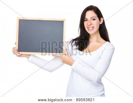 Brunette woman hold with black board