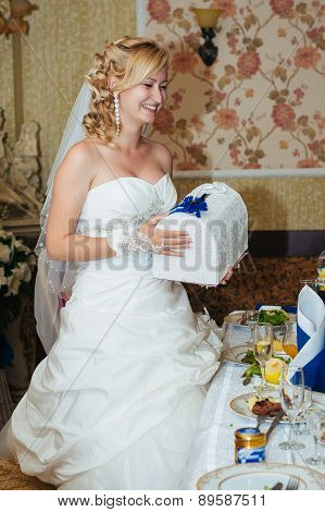 Beautiful sensual  bride in a luxurious restaurant at wedding day, newlywed romantic woman with wedd