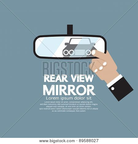 Car's Reflection In Rear View Mirror.