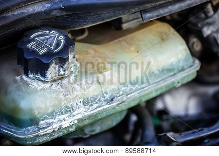 Old Coolant Container In A Car's Engine Bay