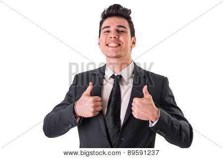 Young businessman doing thumbs up sign