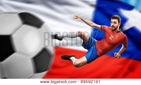 Soccer player on red and blue uniform on chilean flag background