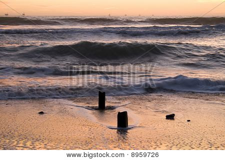 Waves and old pier pilings