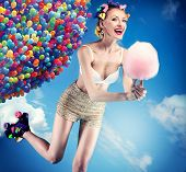 pic of candy cotton  - Beautiful crazy girl riding rotifers holding sweet candy cotton - JPG