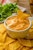 picture of dipping  - Tortilla chips with cheese dip and barbecue czech beer - JPG