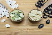foto of seed  - Edible seeds in wood spoon on wood background - JPG