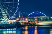 pic of ferris-wheel  - Seattle Waterfront and Illuminated Ferris Wheel at Night Seattle Washington United States - JPG