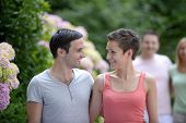 picture of heterosexual couple  - Portrait of a happy young heterosexual couple flirting - JPG